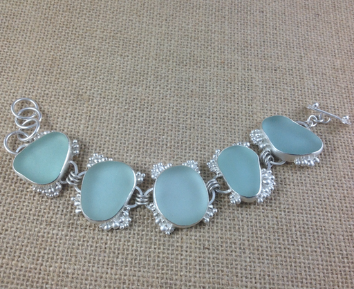 Rare Caribbean blue sea glass bracelet with lots of frothy bubbles. Pass the mojitos - perfect for wrists and relaxation!