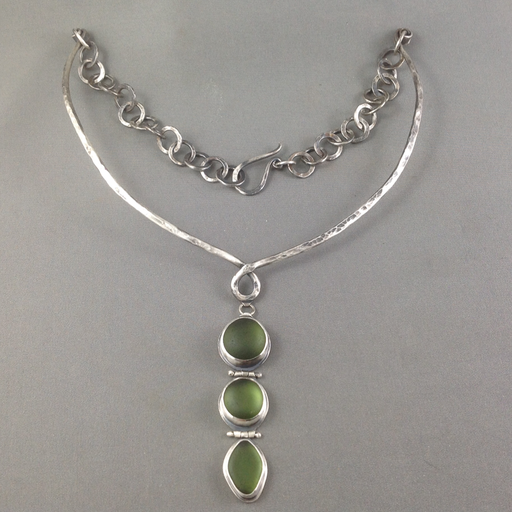 This necklace is half choker and half hand-forged chain which provides a very comfortable fit. The deep green sea glass is perfectly matched and has an enviable glow.