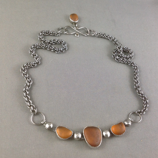Amber sea glass on a fitted throat bar with slinky custom silver chain and matching dangler.