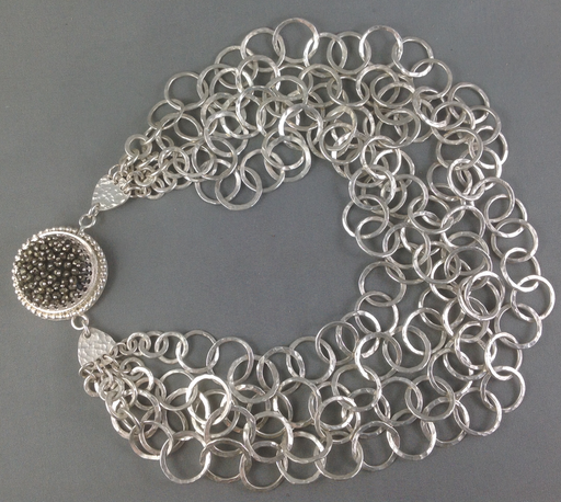"""""""Ava Gardner"""" is an homage to the over-the-top jewellery fashions of the 1950's. This chain has four sets of hammered links of graduated sizes and is closed with a hidden clasp. Ava was awarded """"Best Jewellery"""" at the Sooke Fine Arts Show in 2012."""