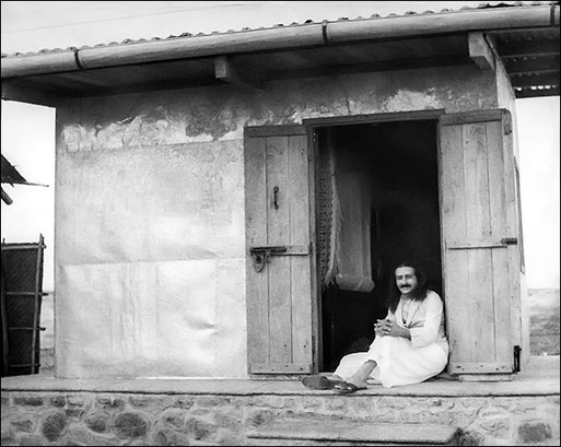 Baba sitting on the cabin threshold in 1937 or '38-Photo courtesy of the Trust Archives