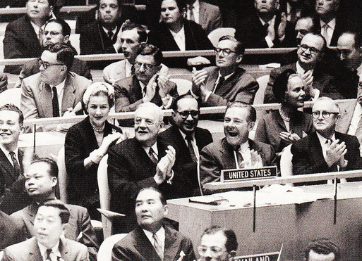 Madam Delegate - Appointed in 1957 by President Eisenhower as a delegate to the 12th General Assembly of the United Nations, Dunne, in the white hat, takes her seat behind Secretary of State John Foster Dulles