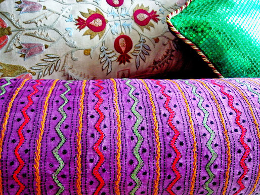 Close up kantha stitch, wool embroidery on bolster, cushion cover.