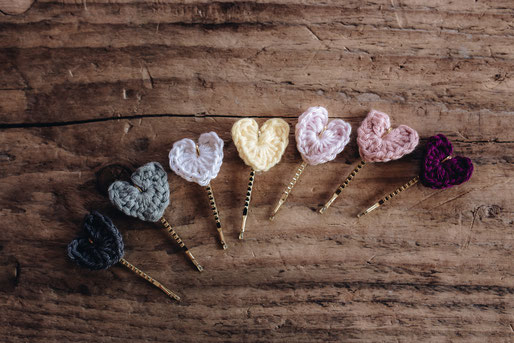 golden hair clips with crocheted heart