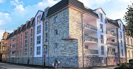 Noch ist die triste Ecke an der Grüntalstraße mit Garagen bebaut, aber im kommenden Jahr soll sie so aussehen, wenn 21 generationsgerechte Eigentumswohnungen fertiggestellt sind. Foto: D. Müller, Grafik: Pidun