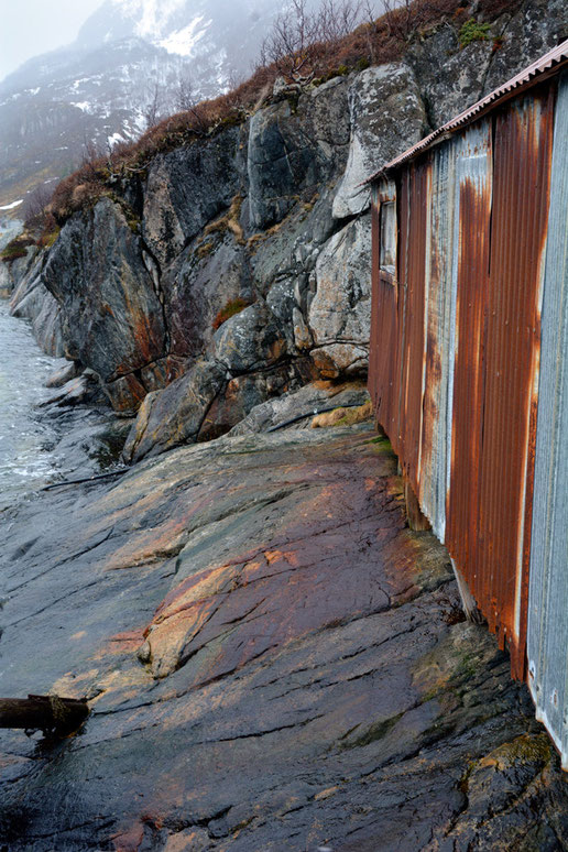 Fishing shed and rocks at Mefjordenbotn on Senja Island.