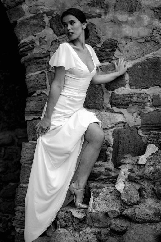 Robe de mariée plissée et bouillonnée