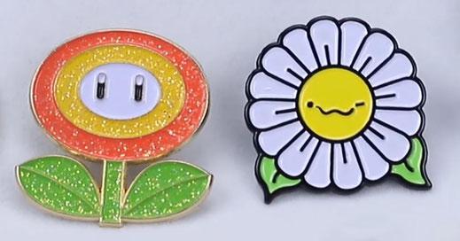 tre spille con la faccina emoji e il logo 1000spille