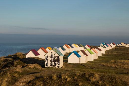 Strandhütten in Gouville-sur-Mer in der Basse-Normandie