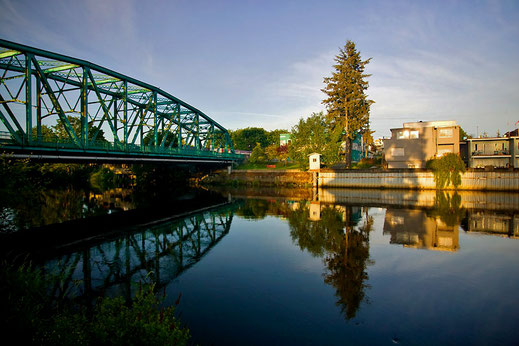 Sun rising on the fifth street bridge and the downtown shores in Courtenay.
