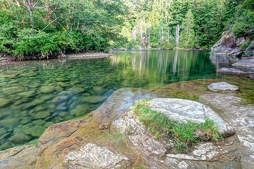 Tranquil clear waters of Barber's Hole on the Puntledge River near Courtenay.