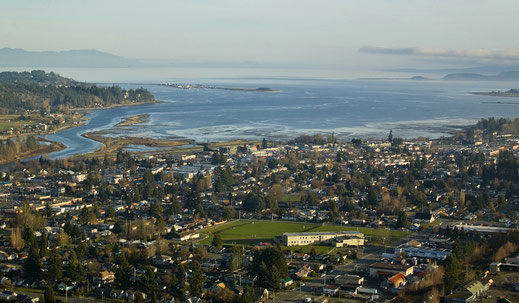 Ariel view of Courtenay with the Comox Harbour.