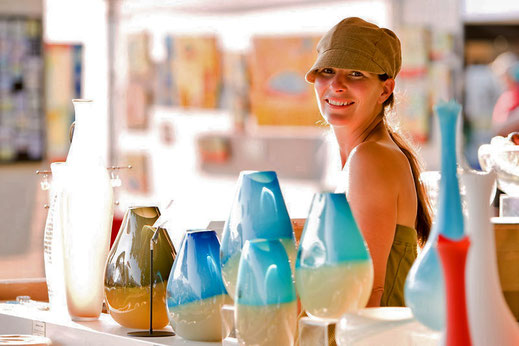 An Artisan with her glassware at the Filberg Festival in Comox.