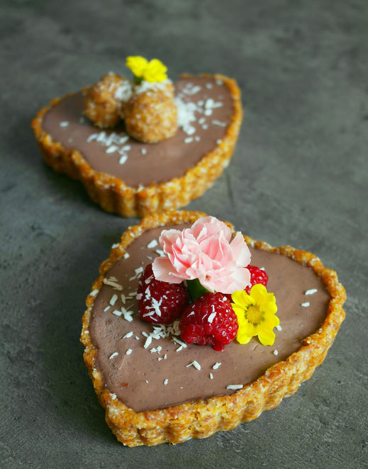 Mini heart shaped tarts filled with chocolate