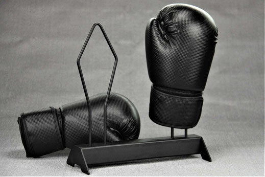 black boxing glove rack with boxing gloves, grey gackground
