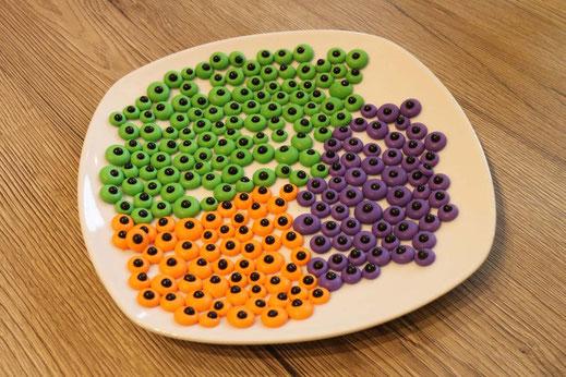 Zuckeraugen in grün, orange und lila