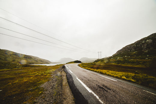 a road winding through the rainy highlands