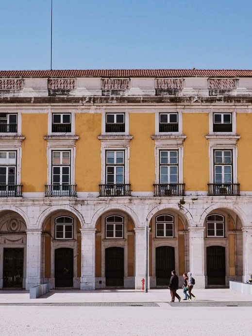Praça do Comércio and its yellow buildings