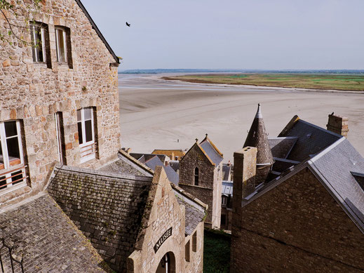 Buildings around the abbey and the sandbank background