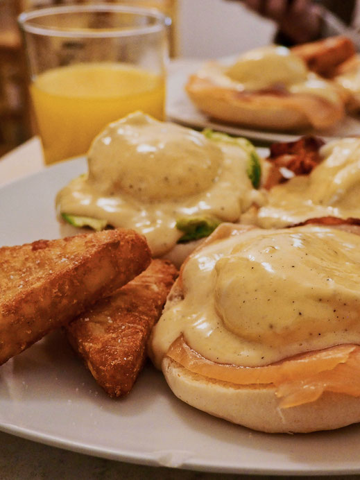 Brunch at Carmencita - Eggs Benedict served with salmon, avocado and bacon