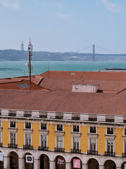 View of the Tagus river and the 25 de abril bridge from the top of Arco da Rua Augusta