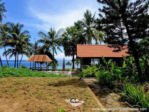 Seraya beachfront land for sale including some bungalows