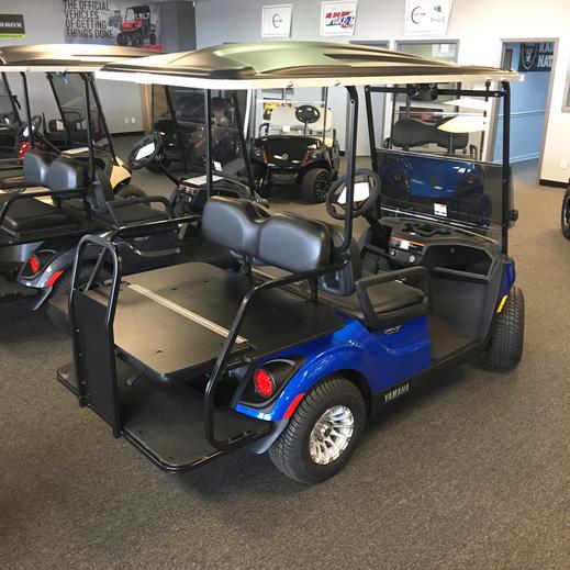 Aqua Blue Metallic Yamaha golf car with factory rear seat