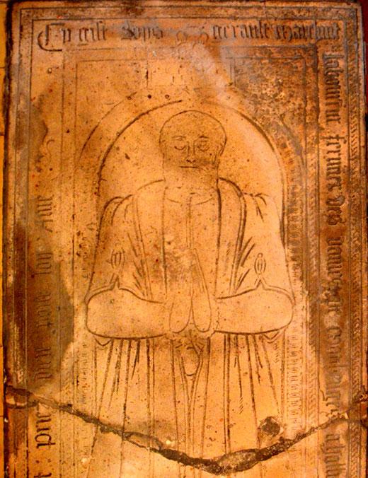 Pierre tombale d'un laboureur dans l'église d'Hallu