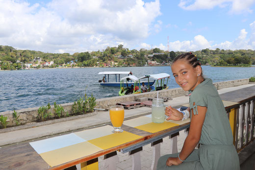 Having drink on the island of Flores, Guatemala