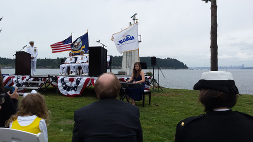A student plays for her father's U.S. Navy retirement ceremony.