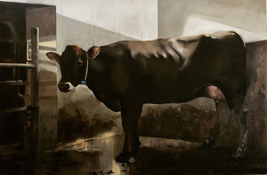 Big painting of a dairy cow in the stable at the milking robot