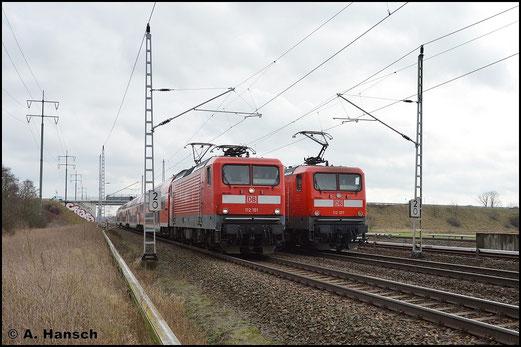 Am 5. Februar 2016 hat 112 101-1 den RE5 nach Rostock Hbf. am Haken. In Französisch-Buchholz (Berlin) trifft sie auf den Gegenzug nach Elsterwerda, der mit 112 107-6 bespannt ist
