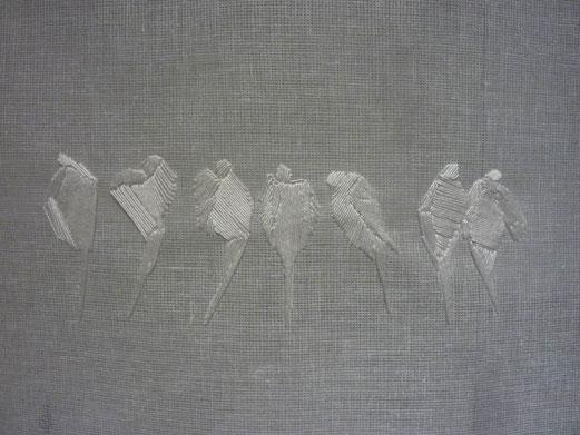 Détail de l'oeuvre montrant le dessin brodé