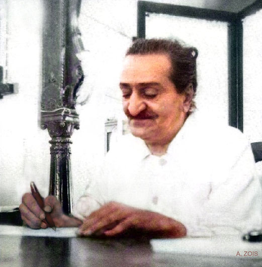 """Meher Baba signing front pages of his book """"God Speaks"""" - 18th March 1955 in Satara, India. Image colourized by Anthony Zois."""