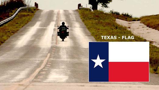 Und schon ist der einsame Gilles wieder unterwegs. - Rechts die Lone-Star-Flagge des Bundesstaates Texas.