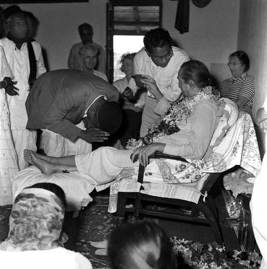 30th June 1957 - Lower Meherabad, India. (L-R) Sadashiv Patil, Laxman Kamble (bowing), Adi K. Irani, Francis & Ola Goldney, Digambar Gadekar next to Baba & Irene Conybeare. Digambar's mother - Gunatai is seated facing Baba .  Photo taken by Meela