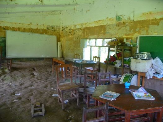 The local communities school house that had been destroyed in a storm, children still come to school here everyday