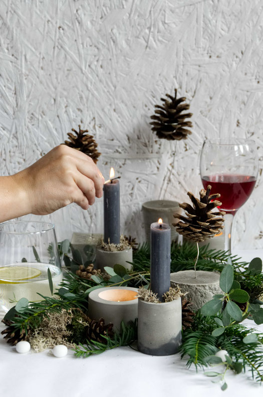 The DIY floating pines featuring in a Christmas centrepiece featuring evergreens and concrete accents by PASiNGA