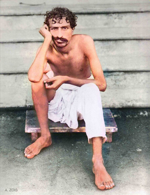 1922 : Meher Baba sitting on the steps of Manzil-e-Meem. Image colourized by Anthony Zois.
