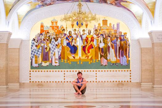 Bastian sitting in Belgrades church