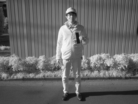 photo of a man holding FineshutKIWAMI took by infrared camera