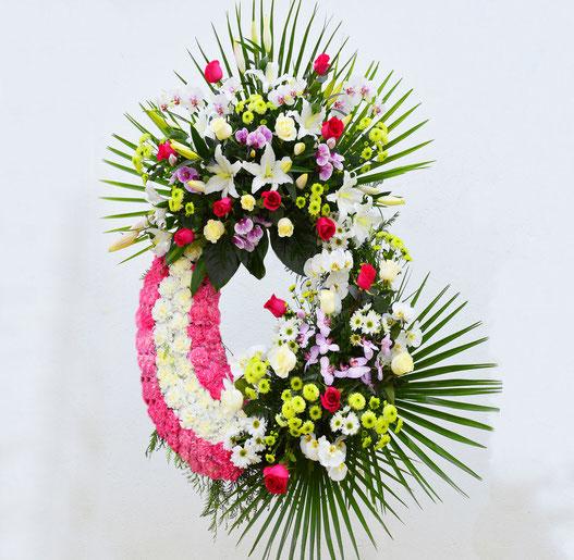 Coronas de flores para los difuntos