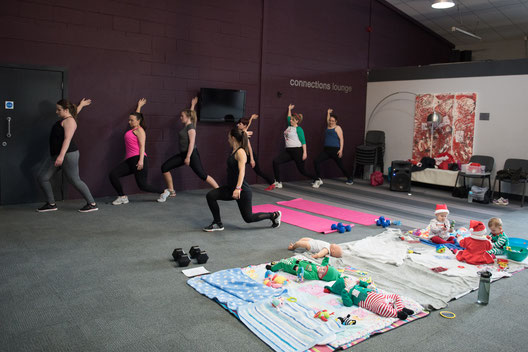 Group Stretching in Mumma Fitness Class