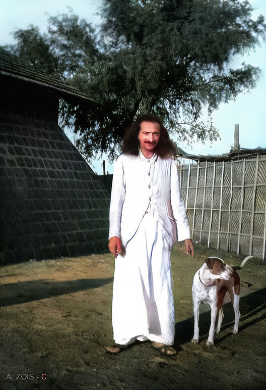 12.  Meher Baba at Upper Meherabad, India with his dog Chum in 1935.
