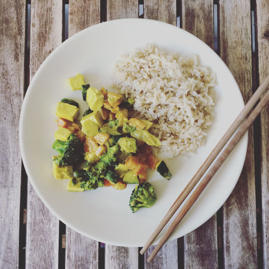 Vegetable Coconut Curry and Brown Rice on a plate