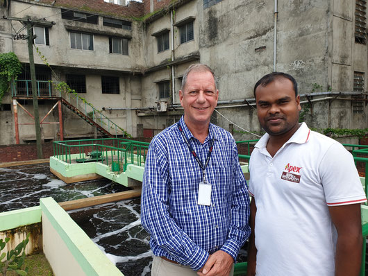 GFA expert Paul Weijeers (left) with Emdadul Haque, Assistant Manager (ETP) in front of the water treatment plant of Apex Footwear