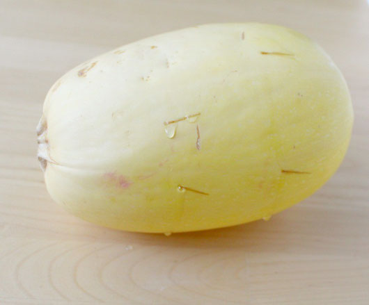 use a sharp knife to carefully poke holes around the spaghetti squash before cooking it whole.