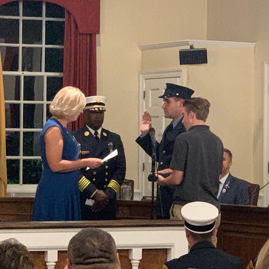 Firefighter Tony Grasso being sworn in by Westfield Mayor Brindle as Westfield Fire Chief Tiller looks on. Tony's brother Nick is holding the bible.