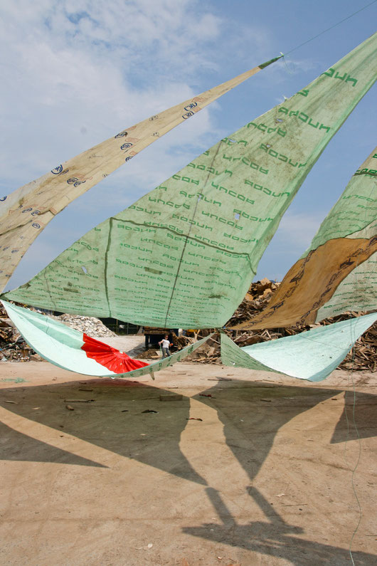 """Untitled (flying sails)"", installation at Recycling Artist in Residency (RAIR) in Philadelphia, PA, forklift, discarded plastic and tyvek, rope, person, 2011"