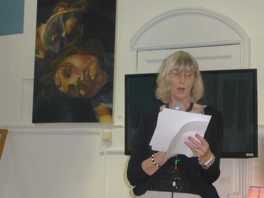 Julie Sampson reading poetry at book launch.
